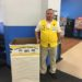 "Wal Mart employee Jeff Nichols is ready to ""Stuff the Bus"" with a collection box at the Presque Isle Wal Mart."