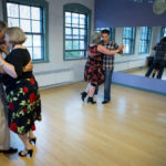 John Hackney (from left), Ginny Hackney, Deb Rollins and Ehsan Tabatabaie dance the Tango while during the monthly Milonga Tango dance party at the Noh Way Dance Studio in Bangor on Friday.