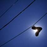 A pair of sneakers hang from a power line on Boynton Street in Portland.