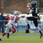 Micah Wright (right) of the University of Maine catches a pass in front of Stony Brook's Travon Reid-Segure at Alfond Stadium in Orono.