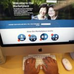 A man looks over the Affordable Care Act (commonly known as Obamacare) signup page on the HealthCare.gov website in New York, Oct. 2, 2013.