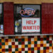 A help wanted sign is posted at a taco stand in Solana Beach, California.