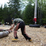 Dylan Kelley competes in a lumberjack obstacle course during the Great Maine Lumberjack Show in Trenton.