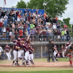 Members of the Orono High School baseball team and their fans celebrate after Connor McCluskey scored the winning run to cap a four-run, seventh-inning rally to beat Lisbon 4-3 in the Class C baseball state championship game at Mansfield Stadium in Bangor, June 17, 2017.
