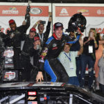 ARCA Series driver Austin Theriault (52) celebrates winning the Lucas Oil Complete Engine Treatment 200 at Daytona International Speedway.