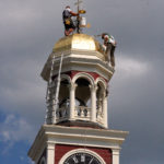 Contractors with Mid-Maine Restoration, Inc. put the finishing touches on the gold leaf project atop the Aroostook County Superior Courthouse in Houlton. The clock tower cupola was restored with gold leaf thanks to a private fundraiser.