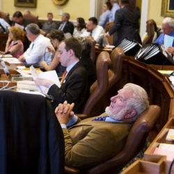 Sen. Dave Woodsome (right), R-North Waterboro, leans back in his chair while listening to arguments during the Senate's hearing on the state budget at the Maine State House in Augusta ahead of the 2017 government shutdown.