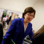 Sen. Susan Collins, R-Maine, accompanied by Sen. Roger Wicker, R-Minnesota, speaks with reporters ahead of a vote on Capitol Hill in Washington, Aug. 2, 2017.