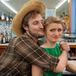 """Bo Decker (Andy Schnabel) hugs a reluctant Cherie (Ali Fitzpatrick) in Acadia Repertory Theatre's production of William Inge's """"Bus Stop."""""""