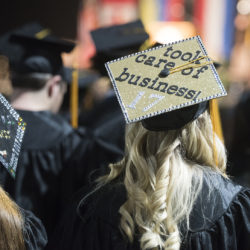 An unidentified Husson University graduation uses her mortarboard to show that she &quottook care of business&quot during the 2017  commencement at the Cross Insurance Center.