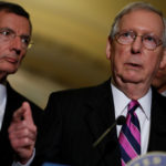 Senate Majority Leader Mitch McConnell, accompanied by Sen. John Barrasso, R-Wyoming, speaks with reporters following the party luncheons on Capitol Hill in Washington, Aug. 1, 2017.
