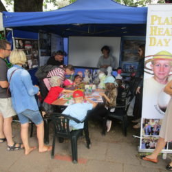Hundreds of parents and children stopped by a festival booth in Szczecin, Poland, this week where University of Maine at Presque Isle professor Kevin McCartney invited them to paint planets and learn about Planet Head Day in Maine.