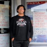 Spiro Paras, whose family's pizza parlor has been closed since 2010 during a years-long dispute with the town of York over permitting, stands near the business in 2015.