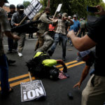 Counter demonstrators attack a white supremacist during a rally in Charlottesville, Virginia, Aug. 12, 2017.