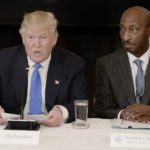 President Donald Trump speaks as Kenneth Frazier, chairman and CEO of Merck, looks on during a listening session with manufacturing CEOs in the State Dining Room of the White House in Washington, D.C., Feb. 23, 2017.
