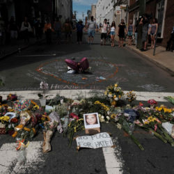 Flowers and a photo of car ramming victim Heather Heyer lie at a makeshift memorial in Charlottesville, Virginia, August 13, 2017.