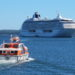 A tender ferries passengers back to the cruise ship Crystal Serenity as it sits anchored off Bar Harbor in Frenchman Bay in September 2016. Southwest Harbor and Tremont residents are considering six-month moratoriums on cruise ships in their harbors, fearing greater traffic jams and damage to their fishing industries.