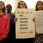Young demonstrators hold signs at a rally and lobby day organized by the Maine Peoples Alliance at the State House in Augusta around the issue of Medicaid expansion, Jan. 8, 2014.