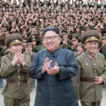 North Korean leader Kim Jong Un claps with military officers at the Command of the Strategic Force of the Korean People's Army in an unknown location in North Korea in this undated photo released by North Korea's Korean Central News Agency, Aug. 15, 2017.