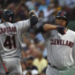 Cleveland's Edwin Encarnacion (right) celebrates with Carlos Santana after hitting a two-run home run in the fifth inning of Monday's game against the Boston Red Sox at Fenway Park. Bob DeChiara | USA TODAY Sports