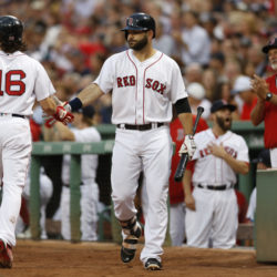 Boston Red Sox first baseman Mitch Moreland (right) welcomes left fielder Andrew Benintendi to the dugout after scoring a run against the St. Louis Cardinals during the first inning at Fenway Park in Boston on Tuesday night.