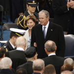President George Bush and Laura Bush arrive at the inauguration on Jan. 20, 2017 in Washington, D.C. Both Bush and his father, H.W. Bush, have issued an implicit rebuke of the current president Wednesday regarding racial bigotry.