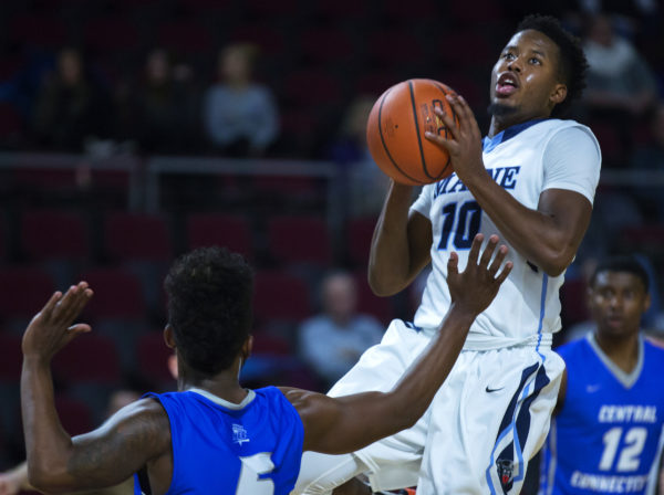 University of Maine's Wes Myers (right) tries for two past Central Connecticut State University's Eric Bowles during their basketball game in November 2016.