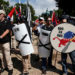 White supremacists stand behind their shields at a rally in Charlottesville, Virginia, on August 12, 2017.
