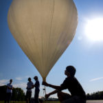 Kent Seneres, a senior computer engineering major from Saco, takes part in a test launch of a high-altitude balloon that will film the coming solar eclipse on Monday morning, Aug. 14, at the Pittsfield Municipal Airport. The eclipse is Aug. 21.