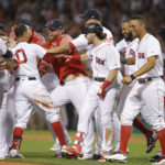 Boston's Mookie Betts (50) celebrates his game-winning hit with teammates against St. Louis at Fenway Park in Boston on Wednesday night.