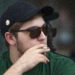 A Bangor resident enjoys a cigarette during his smoke break.