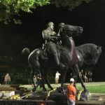 "Workers remove the monuments to Robert E. Lee, commander of the pro-slavery Confederate army in the American Civil War, and Thomas ""Stonewall"" Jackson, a Confederate general, from Wyman Park in Baltimore, Maryland, U.S. August 16, 2017.  Courtesy of Alec MacGillis/ProPublica via REUTERS"