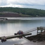 A boat is tied up to a dock on the Penobscot River in Bucksport in this 2014 file photo. Scientists say that whatever options a federal judge may approve next year for mitigating mercury deposits in the river are likely to be complex and challenging.