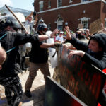 White supremacists clash with counter protesters at a rally in Charlottesville, Virginia, on August 12, 2017.