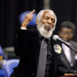Activist Dick Gregory delivers a speech during a public viewing and funeral for legendary singer James Brown in Augusta, Georgia, Dec. 30, 2006.