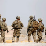 U.S. troops walk outside their base in Uruzgan province, Afghanistan, July 7, 2017.