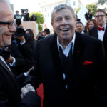 "Cast member Jerry Lewis (center) shakes hands with Cannes Film festival general delegate Thierry Fremaux (left) as he arrives on the red carpet with actor Kevin Pollak (right) for the screening of the film ""Max Rose"" during the 66th Cannes Film Festival in Cannes, France, May 23, 2013."