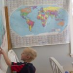"Evan Gerbi, 5, points out places on a map of Maine at his home in Orono. The Gerbi family homeschools their four children and practices ""un-schooling,"" where they don't follow a curriculum, but rather look at teaching as learning through life and experiences."