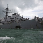 The U.S. Navy guided-missile destroyer USS John S. McCain is seen after a collision in Singapore waters, Aug. 21, 2017.