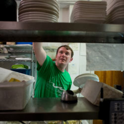 BDN coastal reporter Nick McCrea tries his hand at dish washing during a night shift at the Front Street Pub in Belfast.