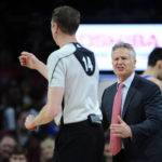 Philadelphia 76ers head coach Brett Brown reacts to a call by referee Ed Malloy (14) during the second quarter against the Detroit Pistons at The Palace of Auburn Hills.