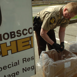 Chief Troy Morton of the Penobscot County Sheriff's Department discards unused prescription medications as part of the National Take-Back Day on April 30, 2011.