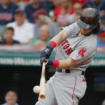 Boston Red Sox left fielder Andrew Benintendi hits a two-run home run in the first inning against the Cleveland Indians at Progressive Field in Cleveland on Monday night.