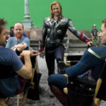 "Robert Downey Jr., from left, Joss Whedon, Chris Hemsworth and Chris Evans are shown on the set of ""The Avengers."""