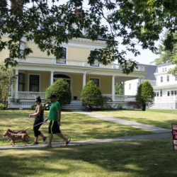 Steven Case and Gabrielle Dandaneau of Virginia Beach walk in Stephen King's neighborhood on Monday. The two Bangor natives said they were surprised to see so many For Sale signs in the neighborhood.