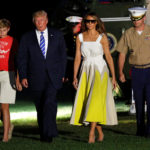 U.S. President Donald Trump walks with first lady Melania Trump and their son Barron (L) on the South Lawn of the White House upon their return to Washington, U.S., after a vacation in Bedminster, NJ., August 20, 2017.