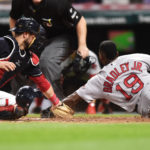 Boston Red Sox center fielder Jackie Bradley Jr. scores ahead of Cleveland Indians catcher Yan Gomes' tag during the seventh inning at Progressive Field in Cleveland on Tuesday night.