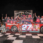 Wayne Helliwell Jr. (left) and his team celebrate in Victory Lane after Helliwell won the 43rd HP Hood Oxford 250 at Oxford Plains Speedway in August 2016.