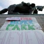 A sign on the statue of Robert E. Lee calls for the park to be renamed for Heather Heyer, who was killed at a far-right rally in Charlottesville, Virginia, Aug. 16, 2017.