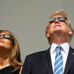 President Donald Trump and Melania Trump watch the solar eclipse from the White House in Washington, Aug. 21, 2017.